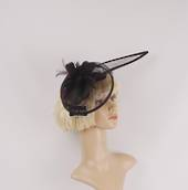 Hatinator in sinamay and feathers w curved extended base, band,  black with a touch of purple. Style: HS/3004/PPLE