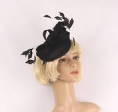 Hatinator with sinamay base and bow, feathers black. Style: HS/3003