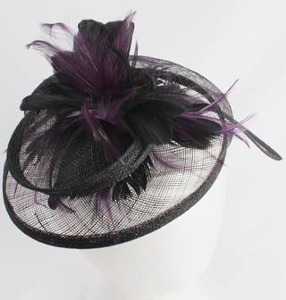 Hatinator in sinamay and feathers w curved extended base, band,  black with a touch of purple. Style: HS/3003/PPLE