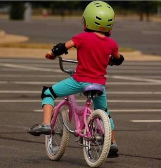 Teaching kids to ride their first bike
