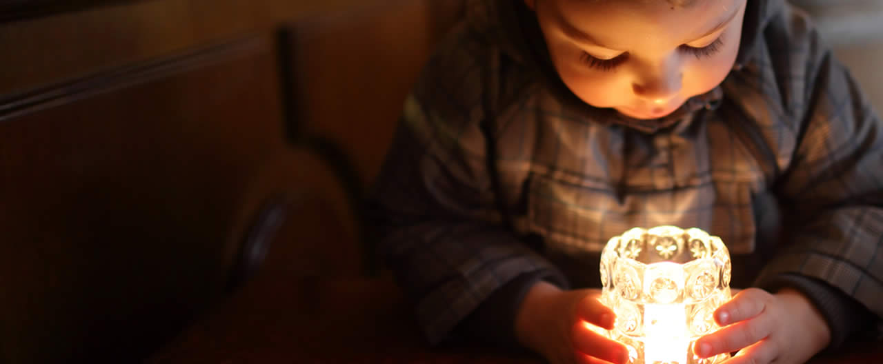 d child and candle