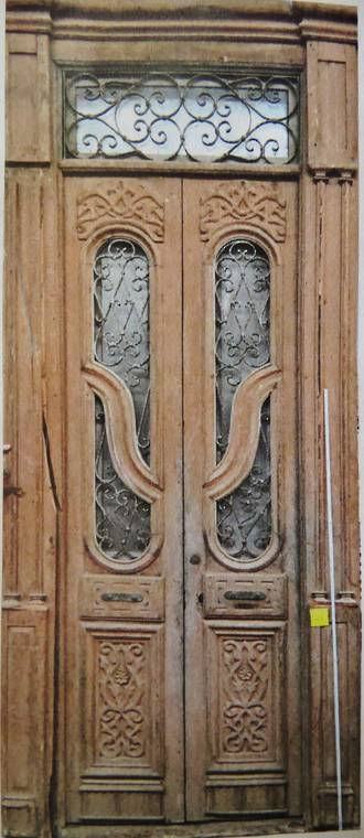 Large Antique Doors with carving and ironwork $5000 pair
