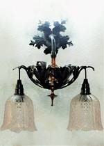 Pair of Double Wrought Iron Wall Sconces With Amethyst Cut Glass Shades